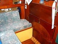 "He then had this custom teak table fashioned with a corresponding ""cut-out"" in the stern berth."