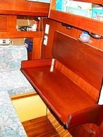 there is a shelf underneath for a lap top computer.