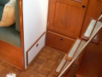Doors to access storage space under the wet locker and at end of starboard settee. Meridian, 139